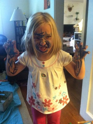 My daughter, who, like the column states, got her hands on the magic markers.