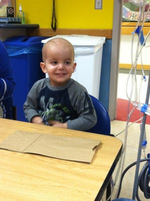 In this 2013 file photo, Jake Honig, then 2, of Howell completed his 28th, and final, radiation treatment on Jan. 15 and is gearing up for his last five chemotherapy treatments. Photo courtesy of the Honig family