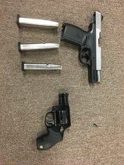 Two guns were recovered during the arrest of two suspected gang members accused in a series of Indio shootings and assaults.