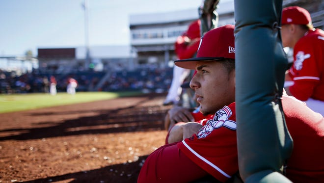 Cincinnati Reds relief pitcher Luis Castillo (58) watches the action from the dugout in the bottom of the eighth inning of the MLB Spring Training game between the San Francisco Giants and the Cincinnati Reds at Goodyear Ballpark in Goodyear, Ariz., on Sunday, Feb. 26, 2017.