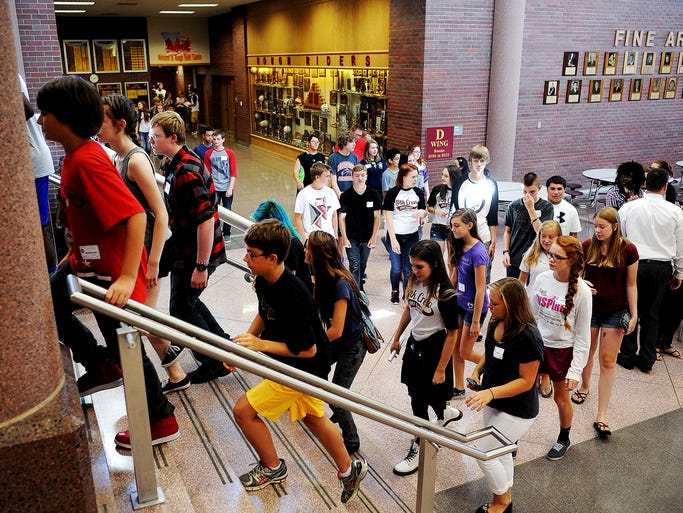 Incoming freshman and Roosevelt High School students in the Link Crew walk up the stairs at Roosevelt High School during tours of the school during Link Crew Freshman Orientation on Wednesday, Aug. 13, 2014, at Roosevelt High School in Sioux Falls, S.D.  According to Tim Hazlett, Roosevelt High School principal, about 600 freshman will start high school at Roosevelt this year.