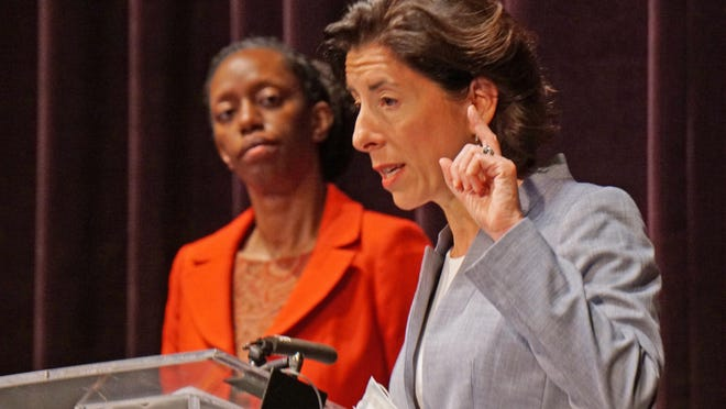 Director of RIDOH Dr. Nicole Alexander-Scott watches on as Governor Gina Raimondo answers a question from the press during her Corona Virus press conference at the Veterans Memorial Auditorium.