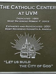 A plaque on the outside of The Catholic Center at UVM