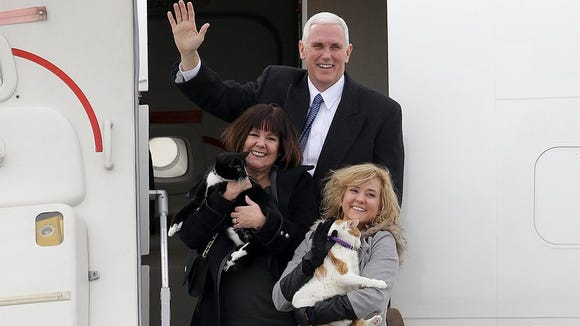 Vice President-elect Mike Pence and his family prepare to depart Indianapolis International Airport for Joint Base Andrews in Maryland on Jan. 9. With him are his wife, Karen; daughter, Charlotte; and cats, Oreo and Pickle.