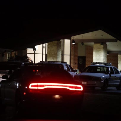Law enforcement outside the Lakeland facility on West