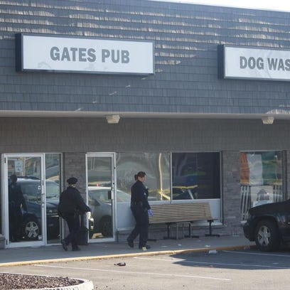 Police investigate outside Gates Pub about 9 a.m. Saturday.