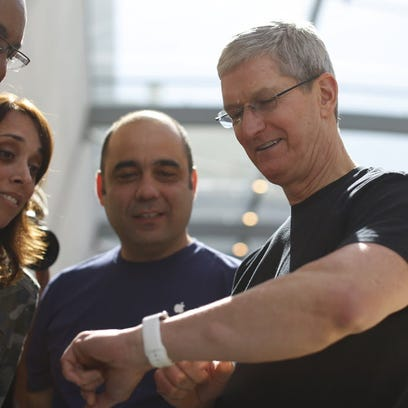 Apple CEO Tim Cook displays his personal Apple Watch