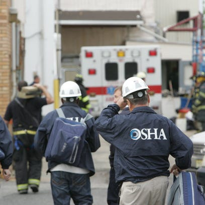 In this May 2012 file photo, an OSHA team arrives at