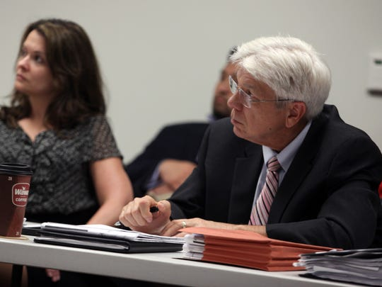Former New Castle County Land Use Manager George Haggerty takes notes at a land use meeting in 2016.