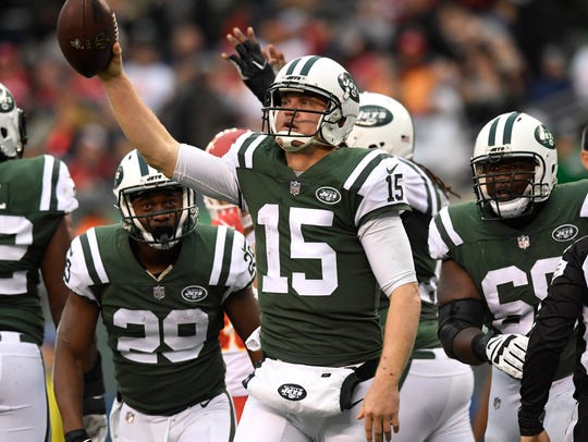 New York Jets quarterback Josh McCown (15) celebrates