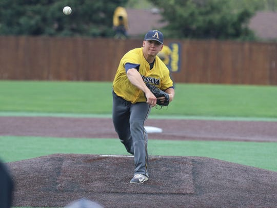 Derek Dahlke pitches to Concordia-St. Paul during the