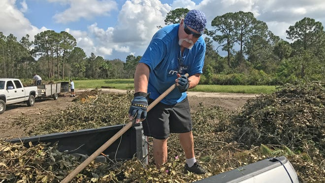 Terry McGugin of Merritt Island empties his pickup of yard debris at the Brevard County Central Disposal Facility in Cocoa.