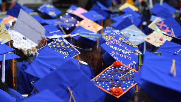 A few of the decorated caps worn by graduating students