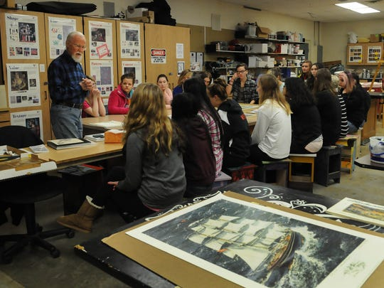 """Internationally renowned artist Charles Peterson, 87, of Ephraim talks about his career as an artist during an art class Wednesday at Sturgeon Bay High School. He is most noted for his """"spirits"""" or ghost images within his watercolor paintings. To see more photos and video of his visit to the class, go to www.doorcountyadvocate.com."""