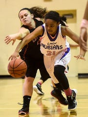 Cardington-Lincoln's Alyson Adams and Africentric's Kynnedy Azubike fight to get control of the ball during the Division III district finals girls basketball game held at Ohio Dominican University on Friday.