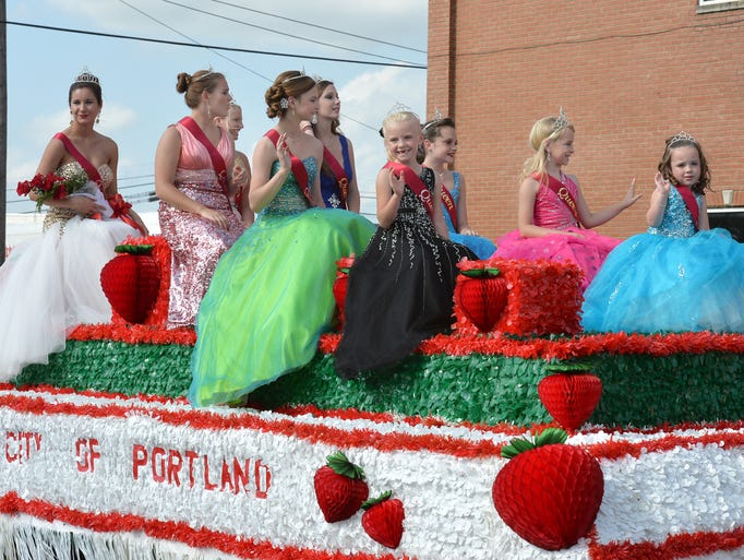 The Strawberry Festival Queens wave to the crowd during the parade Saturday, May 10.
