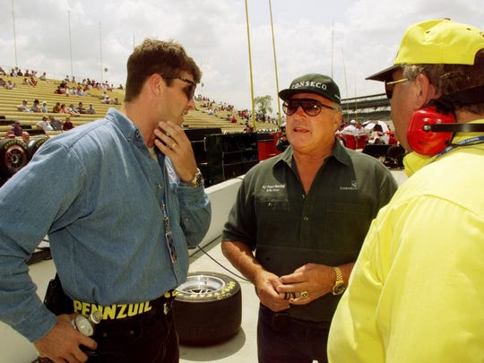 Jim Harbaugh, left, now Michigan's football coach, talks with four-time Indy 500 winner AJ Foyt and former Pennzoil Panther team manager John Barnes on pit row in 1998.