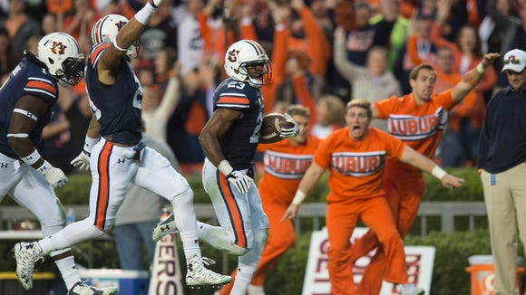 Auburn Tigers defensive back Johnathan Ford (23) returns an interception for a touchdown during the NCAA football game between Auburn and Idaho on Saturday, Nov. 21, 2015, at Jordan-Hare Stadium in Auburn, Ala.