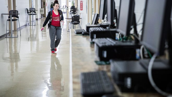 Students walk to class at Ivy Tech's Cowan Road facility Wednesday.