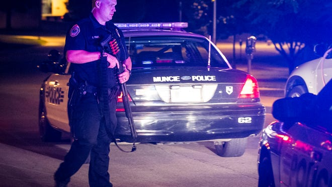 Police searched Ball State University residence halls Thursday evening following a report of a man with a gun.