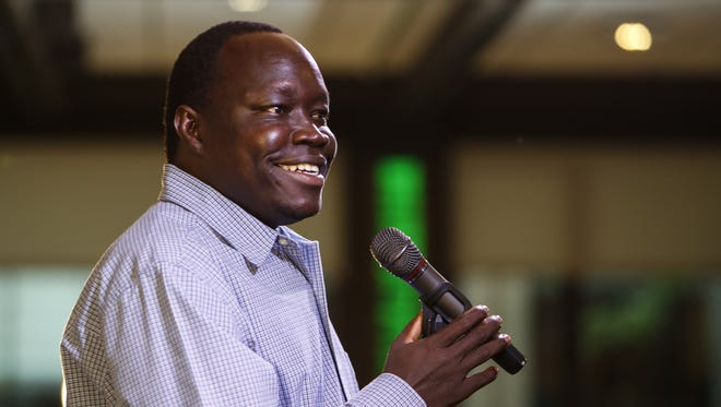 Abraham Majak, a former Lost Boy of Sudan and co-founder of Rescue South Sudan Village People speaks at a Lansing Storytellers Project event in September.