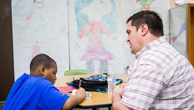 Mentor Dan Vanderbilt works with Sutton Elementary School student Jason Hansbrough after school Tuesday.