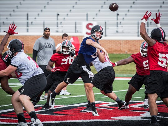 Ball State's Riley Neal runs through a drill with teammates