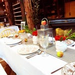 White Deer Ranch near Absarokee holds farm-to-table dinners in an old machine shop, decorated with lights and tables.