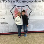 New Richmond swimming coach Judy Middeler, left, helped guide Jordyn Torrens to the Division II state meet in the 100 butterfly last year.