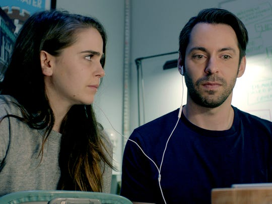 """In """"Operator,"""" a computer programmer (Martin Starr, right) is trying to keep his connection going with his wife (Mae Whitman)."""