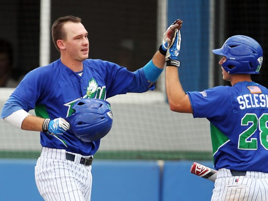 FGCU's Zack Tillery, left, celebrates with Tyler Selesky after Tillery hit a grand slam against Lipscomb on Saturday at Swanson Stadium.