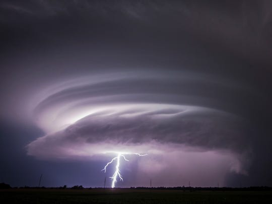 A lightning bolt emerges from a severe thunderstorm