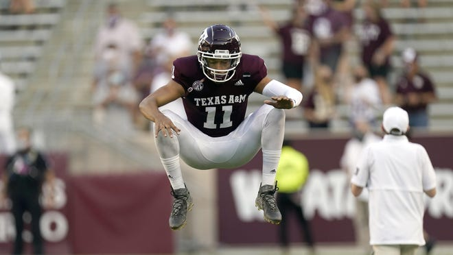 Texas A&M quarterback Kellen Mond stretches before Saturday's season-opening win over Vanderbilt. He completed 17 of 28 passes for 189 yards and a touchdown in the 17-12 win.