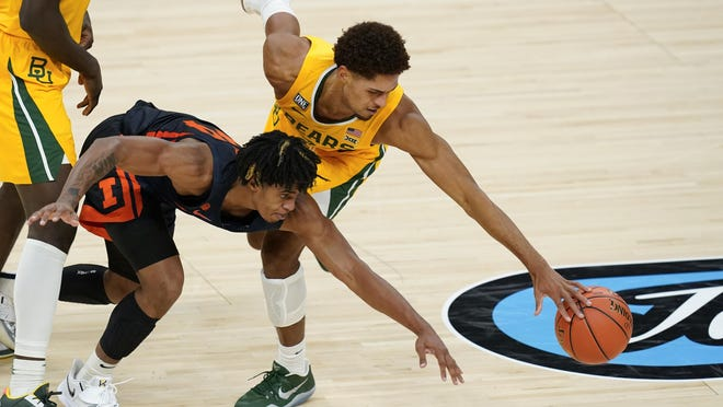 Baylor's MaCio Teague (31) and Illinois' Adam Miller (44) go for a loose ball during the second half Wednesday, Dec. 2, 2020, in Indianapolis.