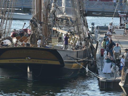 The Pride of Baltimore II docks between the Michigan