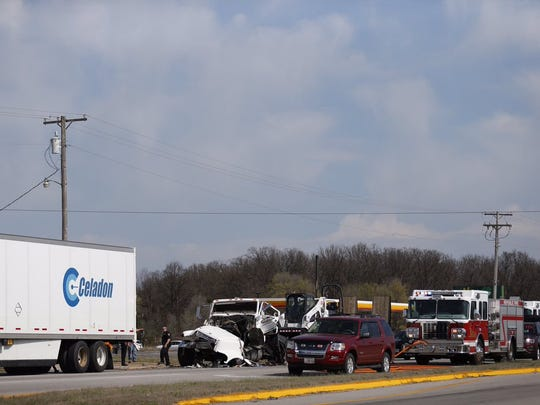Authorities at the scene of a crash on Highway 60 in Republic on Monday.