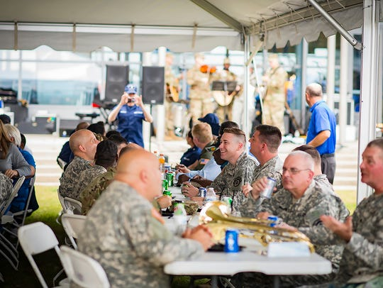 Members of the 129th Army Band take a break from performing