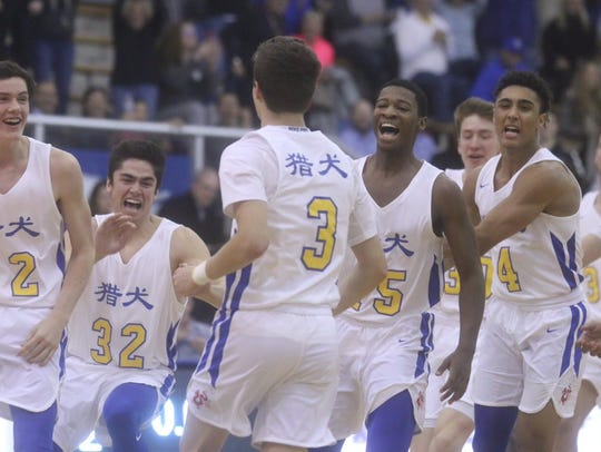Carmel players wore jerseys with Chinese lettering
