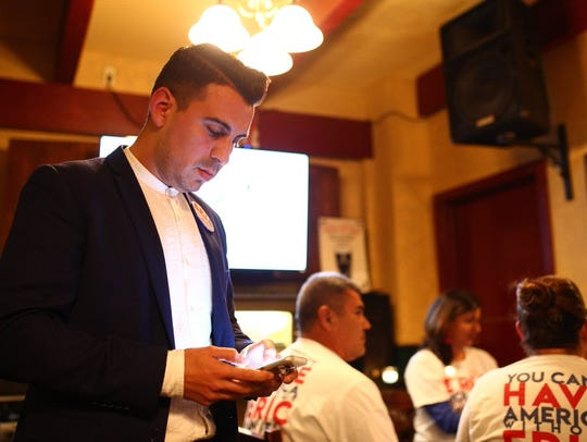 "Eric Holguin, a candidate for the Democratic nomination in the District 27 congressional race primary runoff, watches results arrive in the primary election Tuesday, March 6, 2018, with family and friends at Cassidy's Irish Pub in Corpus Christi. Holguin faces Raul ""Roy"" Barrera in the primary runoff for the Democratic nomination for the seat."