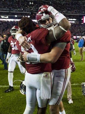 Alabama quarterback Jake Coker (14) and wide receiver ArDarius Stewart (13) hug after defeating LSU at Bryant-Denny Stadium in Tuscaloosa, Ala. on Saturday November 7, 2015. (Mickey Welsh / Montgomery Advertiser)