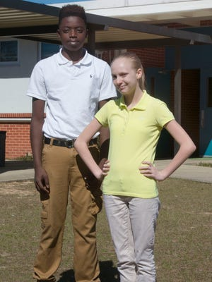 Bellview Middle School students, Janarrius Freeman, left, and Janelle Willis, right, model two of the uniform options for students at the middle school.