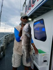 Gene Alexander of Jackson holds up a 10-pound blackfish he caught fishing on the Dauntless party boat.