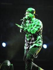 Christian rapper Andy Mineo performs at the 45th Annual GMA Dove Awards at Lipscomb's Allen Arena on Oct. 7, 2014, in Nashville.