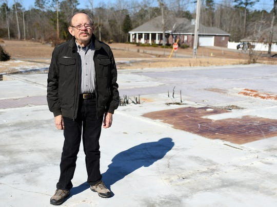 Hal Cox stands where his house stood before the Jan. 21, 2017, tornado. His wife, Simona, was killed in the tornado.