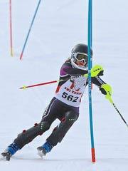 Northville's Elise Daniel swings through the course
