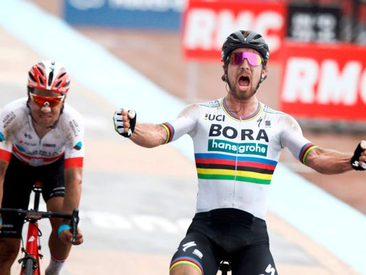 Slovakia's Peter Sagan celebrates after winning the 116th edition of the Paris-Roubaix cycling classic, a 257,5 kilometer (160 mile) one day race, with about 20 per cent of the distance run on cobblestones, at the velodrome in Roubaix, northern France, on Sunday, April 8, 2018. Switzerland's Silvan Dillier finishes second. (AP Photo/Michel Spingler)