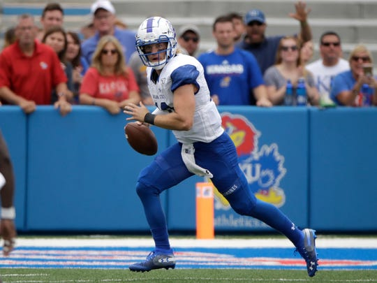 Indiana State quarterback Ryan Boyle (10) looks for a receiver during the second half of an NCAA college football game against Kansas Saturday, Aug. 31, 2019, in Lawrence, Kan. Kansas won 24-17. (AP Photo/Charlie Riedel)
