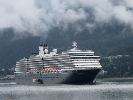 In this Aug. 29, 2011 file photo, the Holland America Westerdam, is shown in Juneau, Alaska. A federal judge in Miami threatened on Wednesday, April 10, 2019, to temporarily block Carnival Corp. from docking cruise ships at ports in the United States as punishment for a possible probation violation.