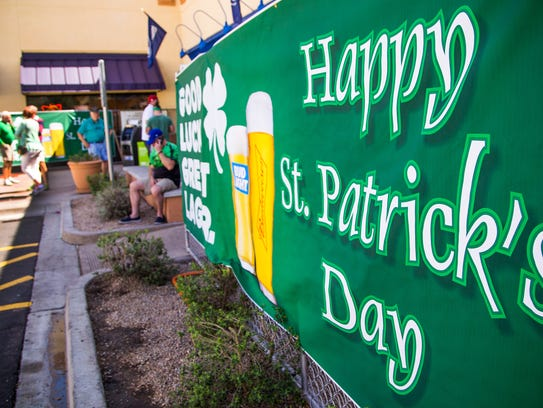 Folks celebrate St. Patrick's Day outside the Skeptical