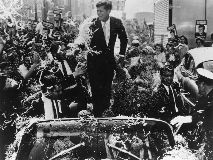 Senator John F Kennedy (1917 - 1963) is given a rousing